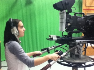 I (Lauren Aguirre) am operating a studio camera.  Throughout the semester, I have crewed for SMU's student news broadcast, The Daily Update.